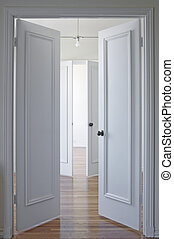 White door and hardwood floor - View through two double...