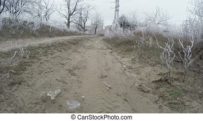 Road in industrial area - Camera on steadicam with low angle...