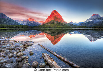 Swiftcurrent Lake at Dawn - Stunning reflections on...