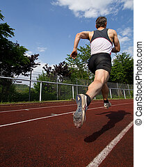 sprinter - sprinting athlet in track and field