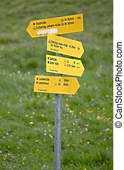 Direction signs in the Alps - Direction signs against clear...