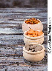 Homeopathic pills in wooden containers on desk
