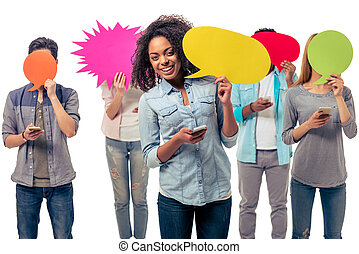 Students with speech bubbles and gadgets - Young people of...