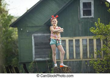 Funny little girl standing