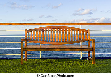Wooden Bench on the Deck of a Cruise Ship - Wooden bench...