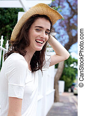 Happy young woman wearing hat