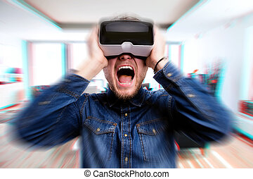 Man wearing virtual reality goggles screaming Home interior...