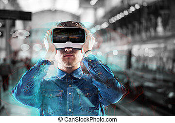 Man wearing virtual reality goggles Subway station - Hipster...