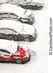 Snow blizzard - Cars parked under heavy snow during blizzard...