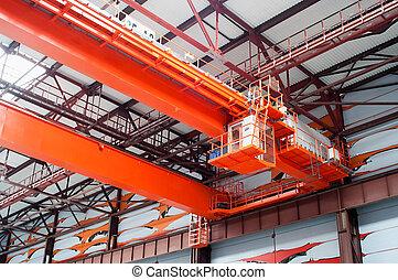 Large-tonnage industrial orange Goliath crane loading of...