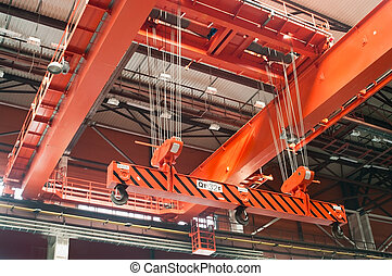 Large-tonnage industrial orange Goliath crane loading of...