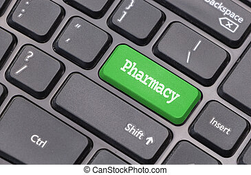"Computer keyboard closeup with ""Pharmacy"" text on green enter key"