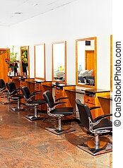 Hair saloon - Modern empty hair saloon with chairs and...