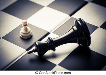 Chess board game - Close-up image of a chess board with...