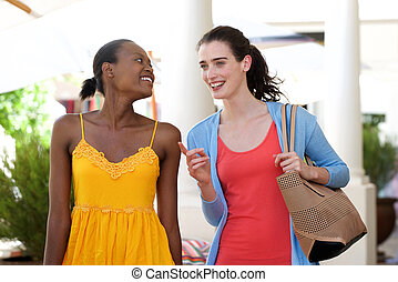 Two women walking and talking outside