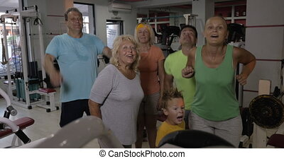 Family getting excited after training together in the gym -...