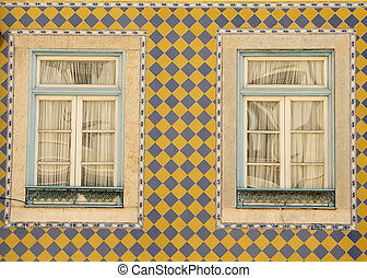 Portuguese ceramic facade with windows - typical tiled...