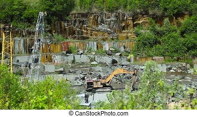 Granite mining in stone quarry