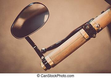 Motorcycle handlebar and mirror - Close up shot of a...
