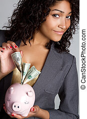 Piggy Bank Woman - Black woman holding piggy bank money