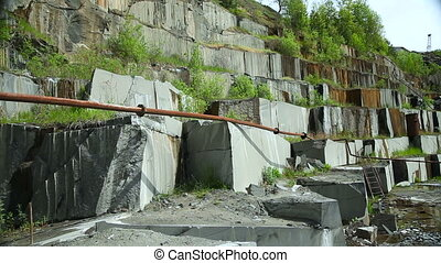 Granite mining in stone quarry - The granite walls in a...