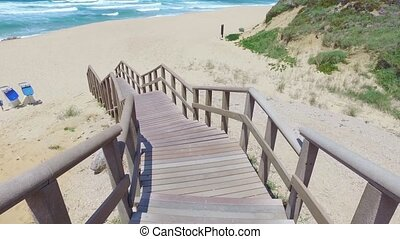 Walk Down via Wooden Stairs with Railing, sunny day