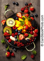 fresh fruits and berries on plate - fresh summer fruits and...