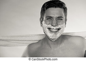 Happy man with half shaved face beard hair. - Portrait of...