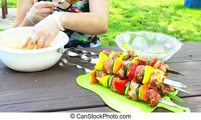 Assorted meat from pork and various on skewers vegetables...