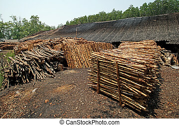 wood for making charcoal - A pile of wood for making...