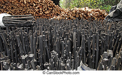 natural wood charcoal - mangrove charcoal, pile of natural...