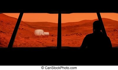 Astronaut Looks Out At Mars Base - Male astronaut looks out...