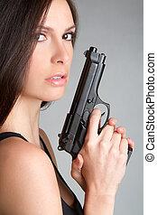 Woman Holding Gun - Sexy brunette woman holding gun