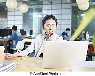 young asian businesswoman working in office - young asian...