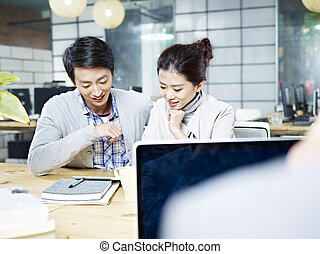 young business man and woman working together in office