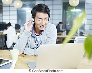 young asian designer working in office - young asian...