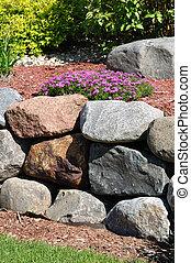 Stone Retaining Wall with Creeping Phlox Flowers