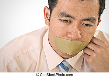 Silent businessman of Asian closeup portrait with tape on...