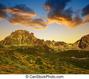 Mountain landscape over Davos in Switzerland Alps at sunset...