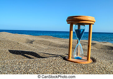 Hourglass Clock on the Sand Beach - Photo Picture of...