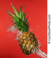 Splash in water with pineapple