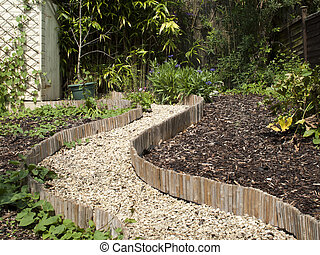 English Garden - English summer garden with gravel winding...