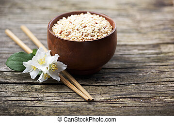 Rice and jasmine flower onrustic wooden table