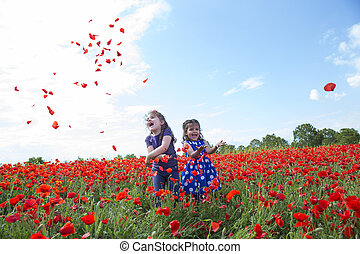 Two smiling girls playing in field