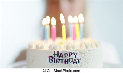 Birthday Cake with Lighting Candles - Closeup shot of...