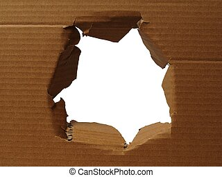 Cardboard with hole torn in the middle
