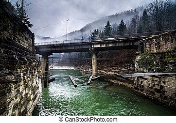 destroyed pedestrian bridge and road-brigde over the river...