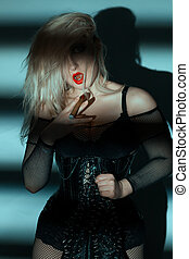Woman with a thick cigar. - Woman with red lips holding fat...