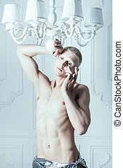 Male albino crying. - Male albino wipes the tears from his...