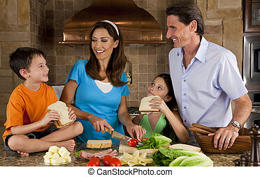 Attractive Family In Kitchen Making Healthy Sandwiches - An...
